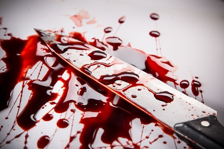 murder scene: Murder concept - knife with blood on white background, close-up. Stock Photo