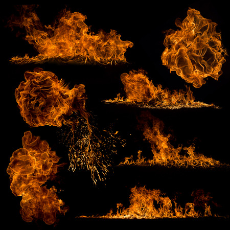 Fuoco fiamme su sfondo nero, close-up. Archivio Fotografico