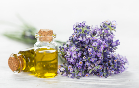 Wellness treatments with lavender flowers on wooden table. Spa still-life. Stock Photo - 56042711