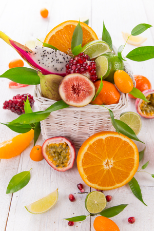 produces: Citrus fresh fruits on a wooden table, close-up.