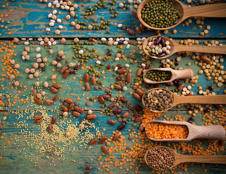 Raw legume on old rustic wooden table, close-up. Stock Photo