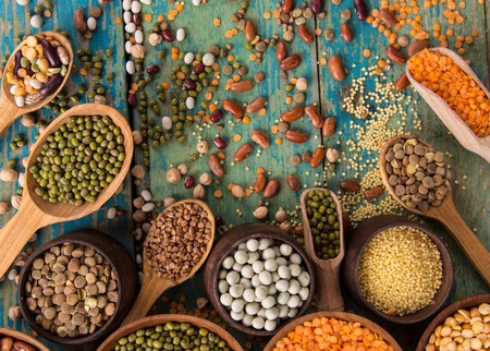 Raw legume on old rustic wooden table, close-up. Standard-Bild