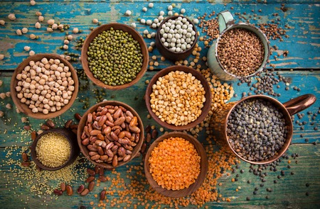 assortment: Raw legume on old rustic wooden table, close-up. Stock Photo