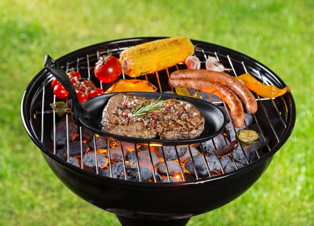 marinate: Assorted delicious grilled meat with vegetable on a barbecue grill.