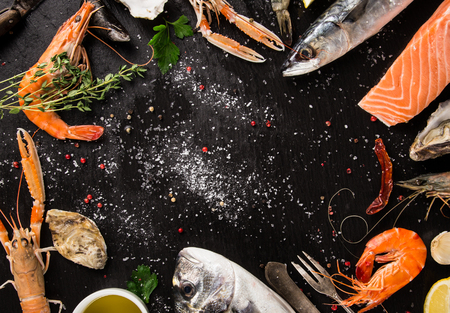 Fresh seafood on black stone, close-up. Stock Photo - 56615691