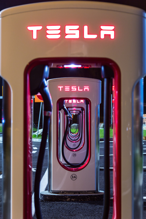 supercharger: BRENNER, AUSTRIA - MAY 11, 2016: Tesla supercharger machine at Supercharger Station at night.
