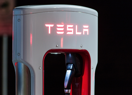 electric station: BRENNER, AUSTRIA - MAY 11, 2016: Tesla supercharger machine at Supercharger Station at night.