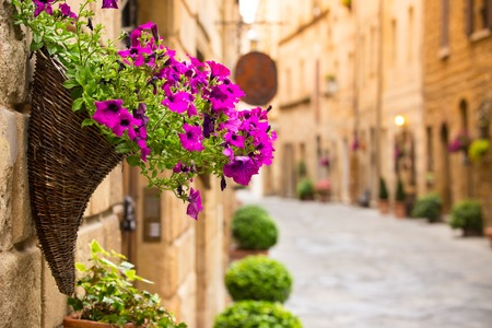 wooden window: View of the ancient old european city. Street of Pienza, Italy.