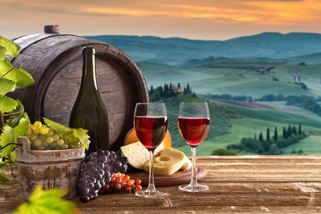 caciocavallo: Delicious cheeses and red wine on old wooden table, close-up. Stock Photo