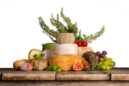 caciocavallo: Delicious cheeses on old wooden table, close-up. Stock Photo