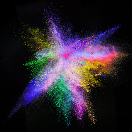 black ink: Freeze motion of colored dust explosion isolated on black background.