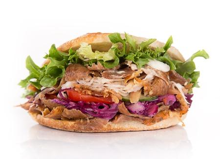 Stretta di panino kebab su sfondo bianco Archivio Fotografico - 57750324