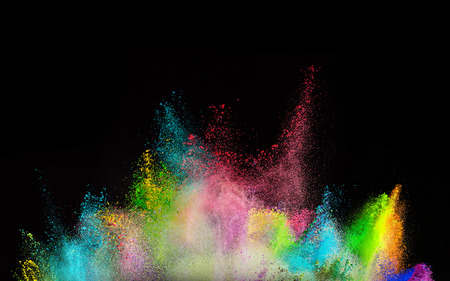 gas ball: Freeze motion of colored dust explosion isolated on black background.