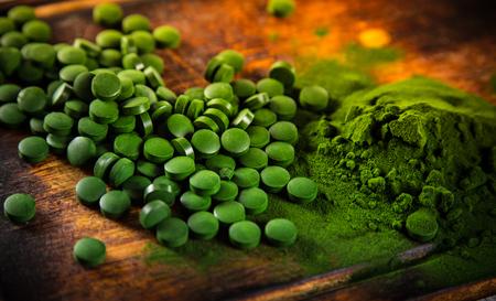 Healthy green young barley and chlorella, close-up.