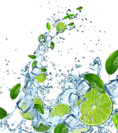 soda: Fresh limes in water splash over white background