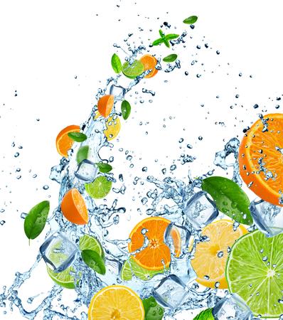 Vers fruit in water splash over wit, close-up.