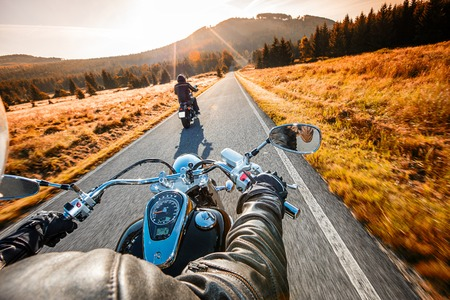 handlebars: The view over the handlebars of high power cruiser motorcycle.