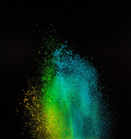 freeze: Freeze motion of colored dust explosion isolated on black background Stock Photo