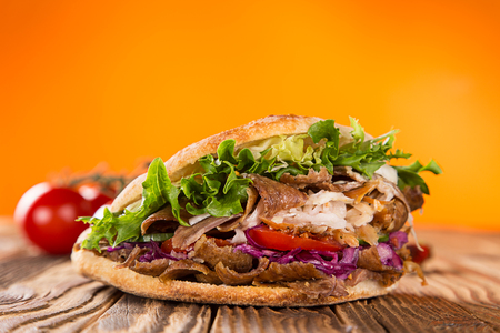 close up of kebab sandwich on white background