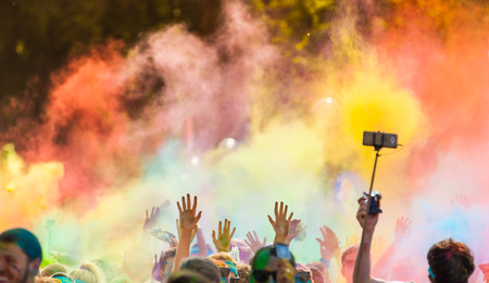 colored powder: Close-up of marathon, people covered with colored powder. Stock Photo