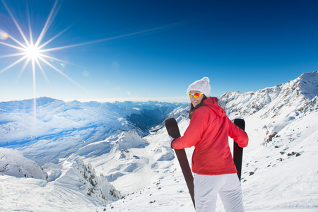 A female skier on the piste in Alps, Austria, Europe.
