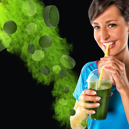 crucible: Green vegetable smoothie. Woman living healthy lifestyle drinking vegetable smoothies. Stock Photo