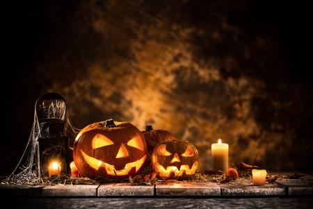 Halloween Pumpkins on old wooden table Stock Photo