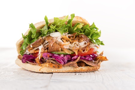close up of fresh tasty kebab sandwich.