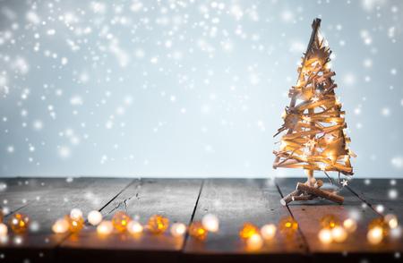 crafted: Christmas decoration on wooden background, close-up.