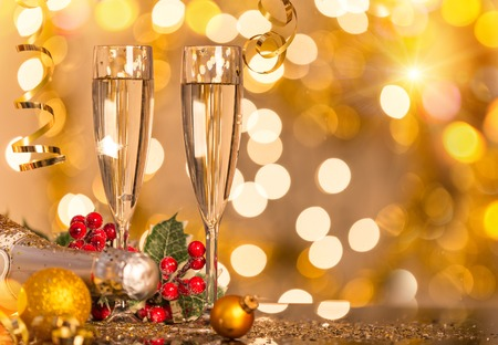 champagne glasses: Glasses of champagne with gold blurred background, celebration theme.
