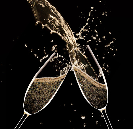 black gold: Glasses of champagne with splash, celebration theme. Stock Photo