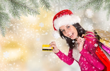 shoppingbag: Christmas Shopping. Beautiful Happy Girl With Credit Card. Christmas Sales