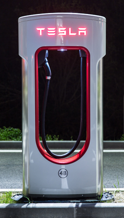 accommodate: BRENNER, ITALY - MAY 8, 2016: Tesla charging stations are located throughout EU to accommodate owners of the electric car.