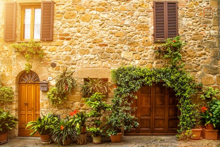 pienza: Flowery streets on a spring day in a small old village Pienza, Tuscany.