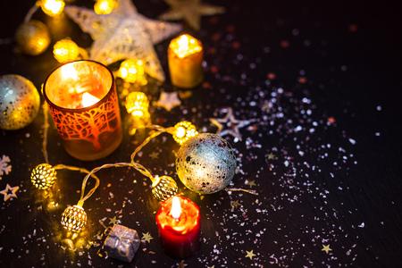 shiny black: Shiny Christmas decorations against a black background Stock Photo