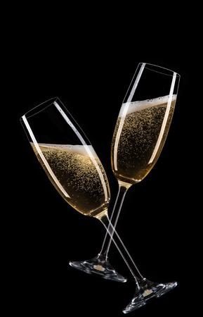 Glasses of champagne with splash, celebration theme. Stock Photo