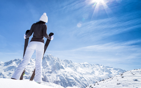 Beautiful brunette woman with ski