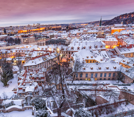 Prague in winter time, view on snowy roofs. Stock Photo