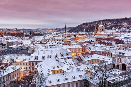Prague in winter time, view on snowy roofs. Imagens