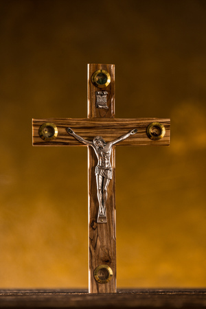 baptized: Close-up of wooden Christian cross.