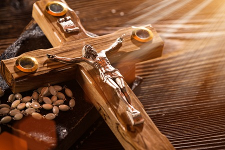 psalm: Close-up of wooden Christian cross.