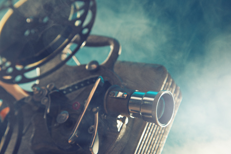 photography: Old style movie projector, close-up.