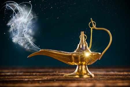 Aladdin magic lamp with smoke. Stock Photo