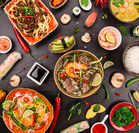 salad bowl: Various of asian meals on rustic background , top view , place for text.
