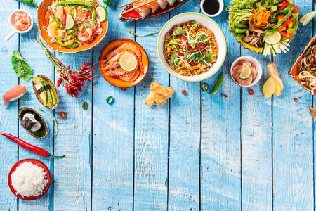 background: Various of asian meals on rustic background , top view , place for text.