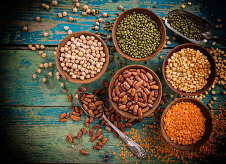 Raw legume on old rustic wooden table. Stock Photo