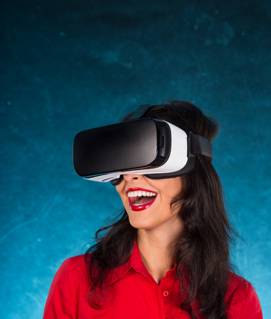 computer simulation: Happy woman with glasses of virtual reality. VR concept. Stock Photo