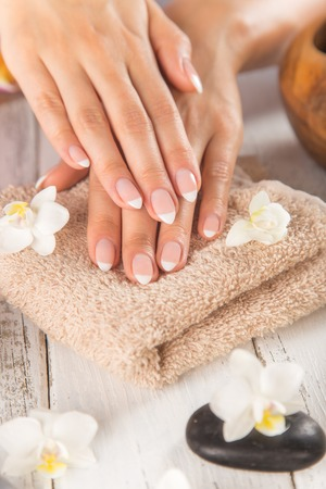 Woman with beautiful manicured nails in spa. Stock Photo