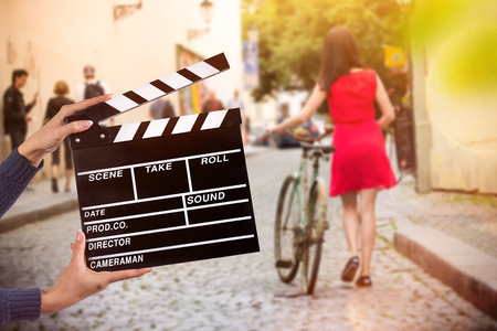 Clapperboard sign hold by female hands. Imagens