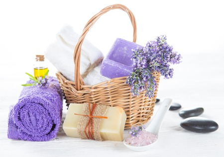 bath essence: Wellness treatments with lavender flowers on wooden table.
